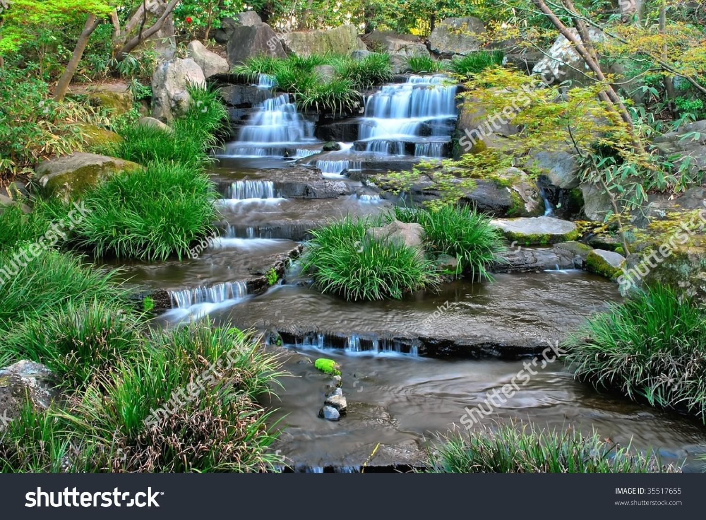 Nice Low Shot Of Majestic Waterfall In A Japanese Zen Garden