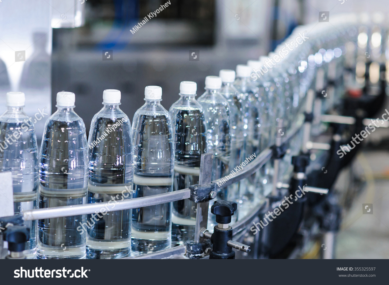 water bottles on production line stock photo 355325597 shutterstock