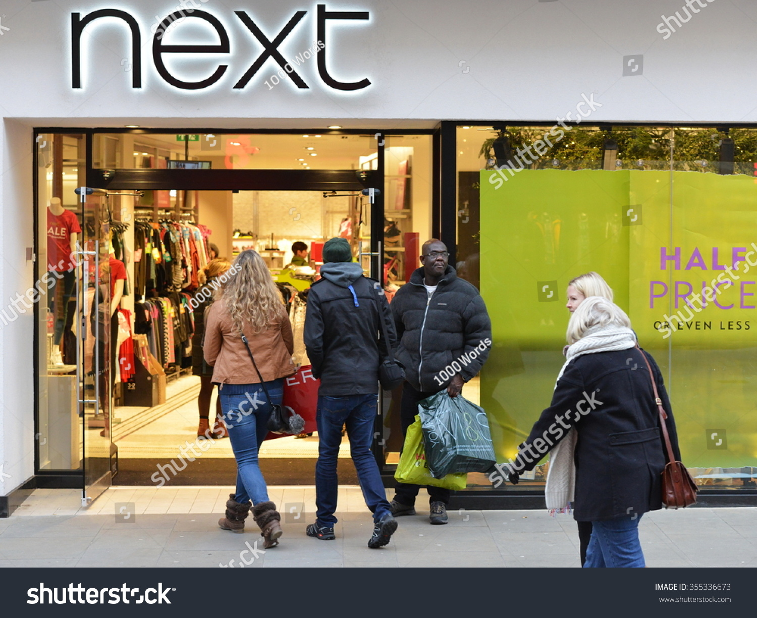 BATH UK DEC 26 2014 People visit stores in Southgate shopping district for the Boxing Day Sales Many stores across the country traditionally hold sales on Boxing Day with have discounted goods