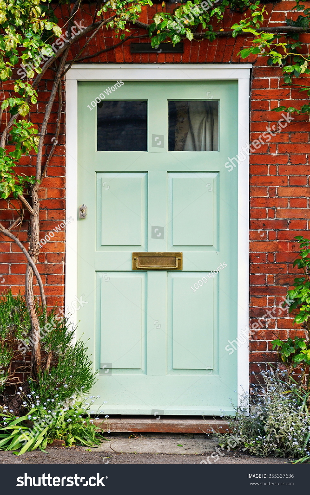 Red front door on brick house - View Of A Beautiful Front Door Of A Red Brick House 355337636