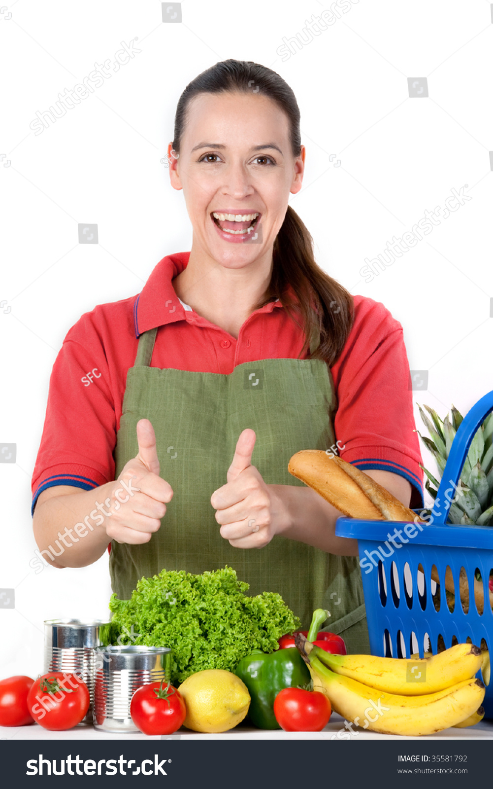 a young friendly grocery store assistant thumbs up stock save to a lightbox