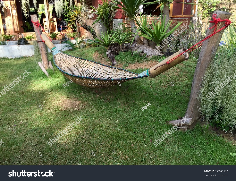 empty bamboo hammock in tropical garden in thailand empty bamboo hammock tropical garden thailand stock photo      rh   shutterstock