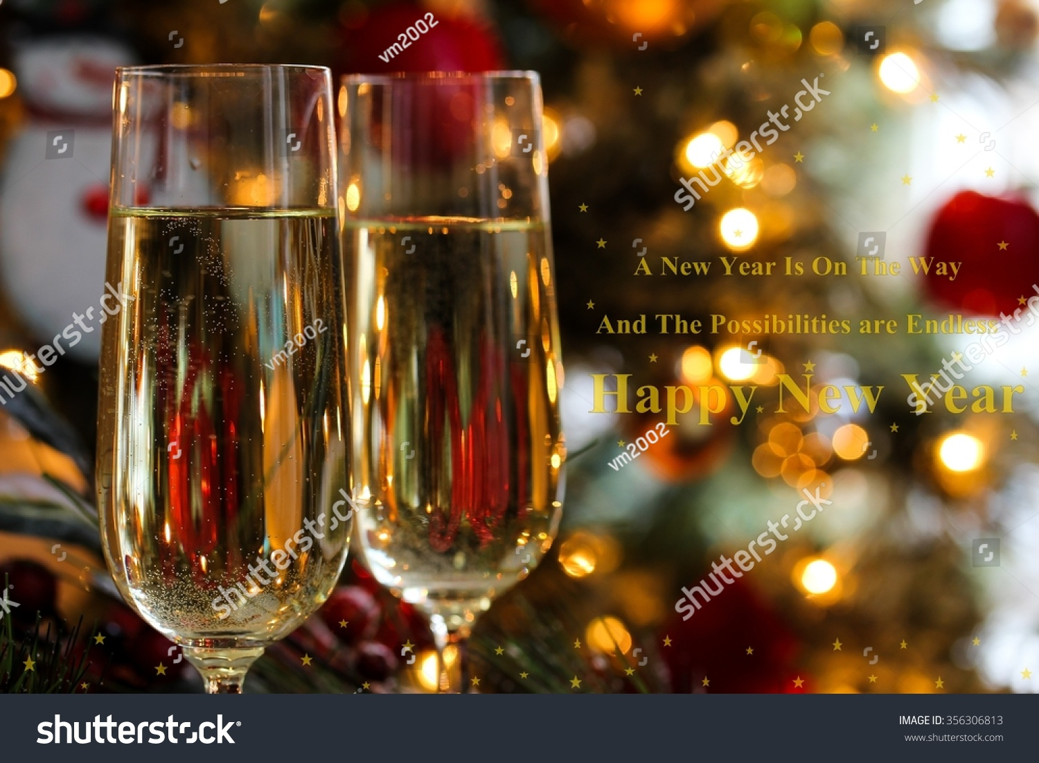 champagne glasses with new year quotes shallow depth of field