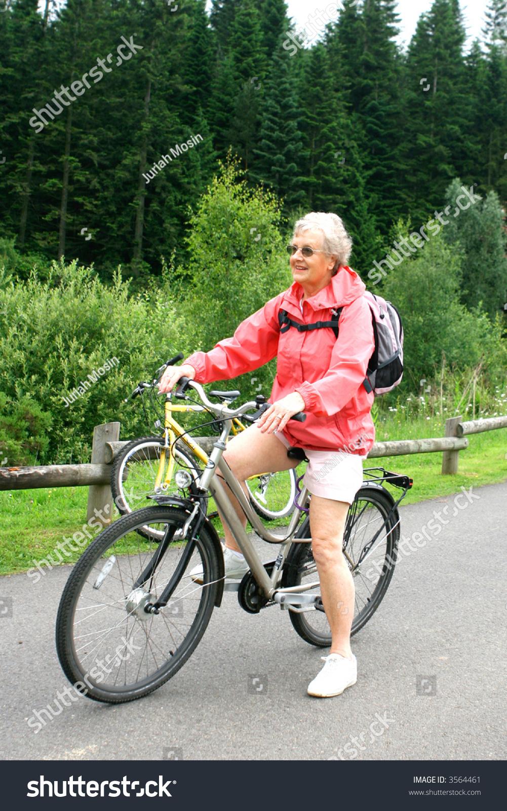 mature woman enjoying outdoor life pine stock photo (royalty free