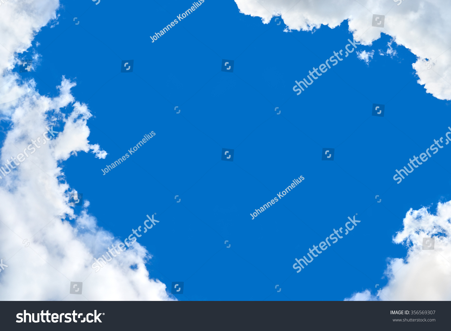 Cloud Frame On Blue Background Stock Photo (Royalty Free) 356569307 ...