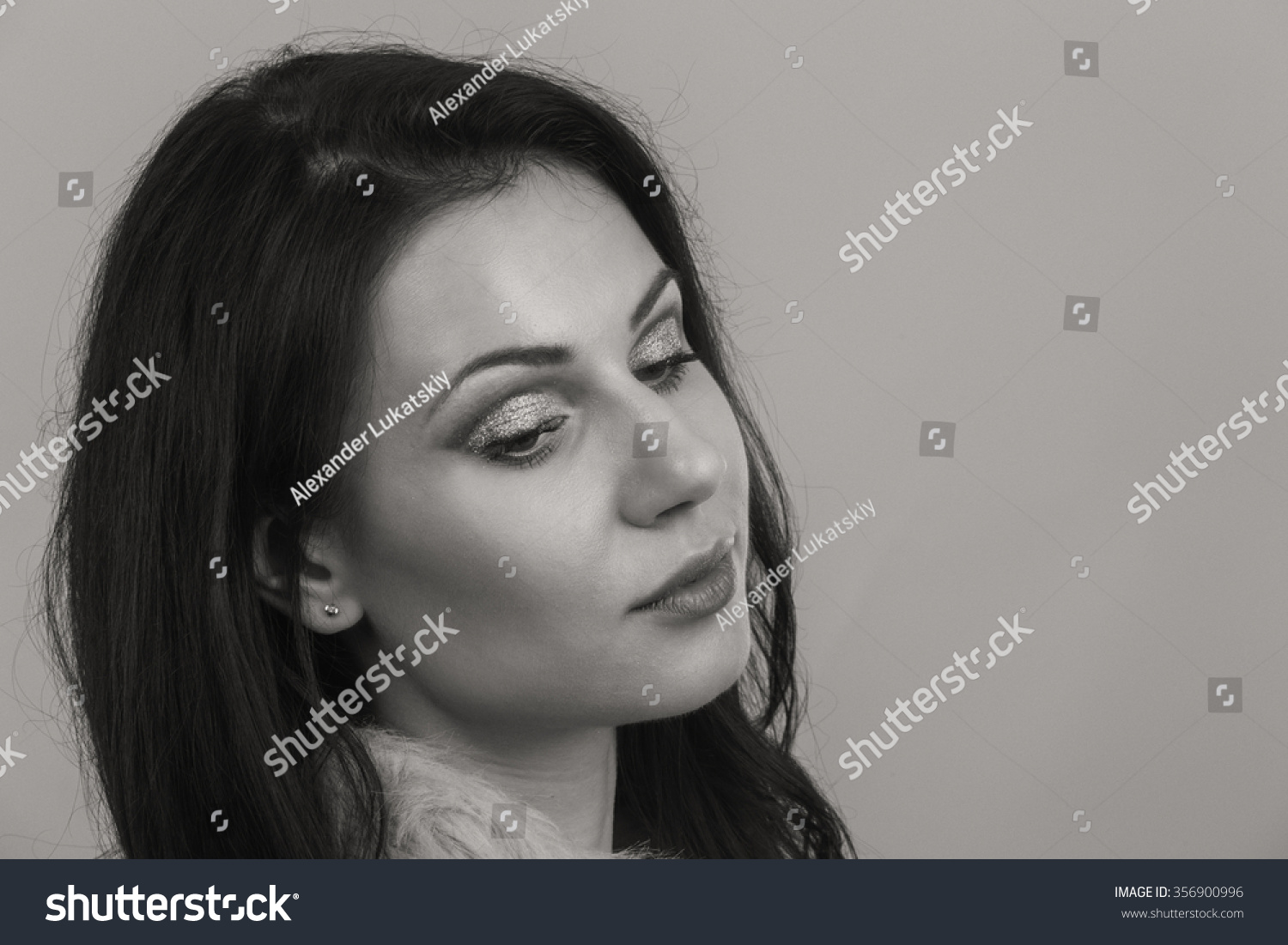 Sexy brunette on a white background. Professional makeup.