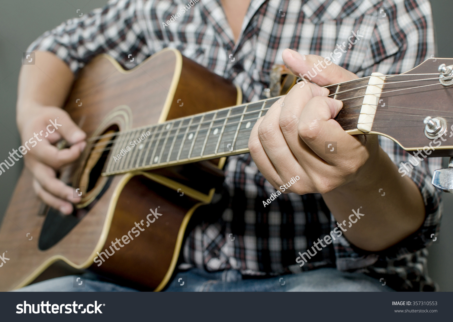 Acoustic Guitar Being Played Fingers Holding A Chord Ez Canvas