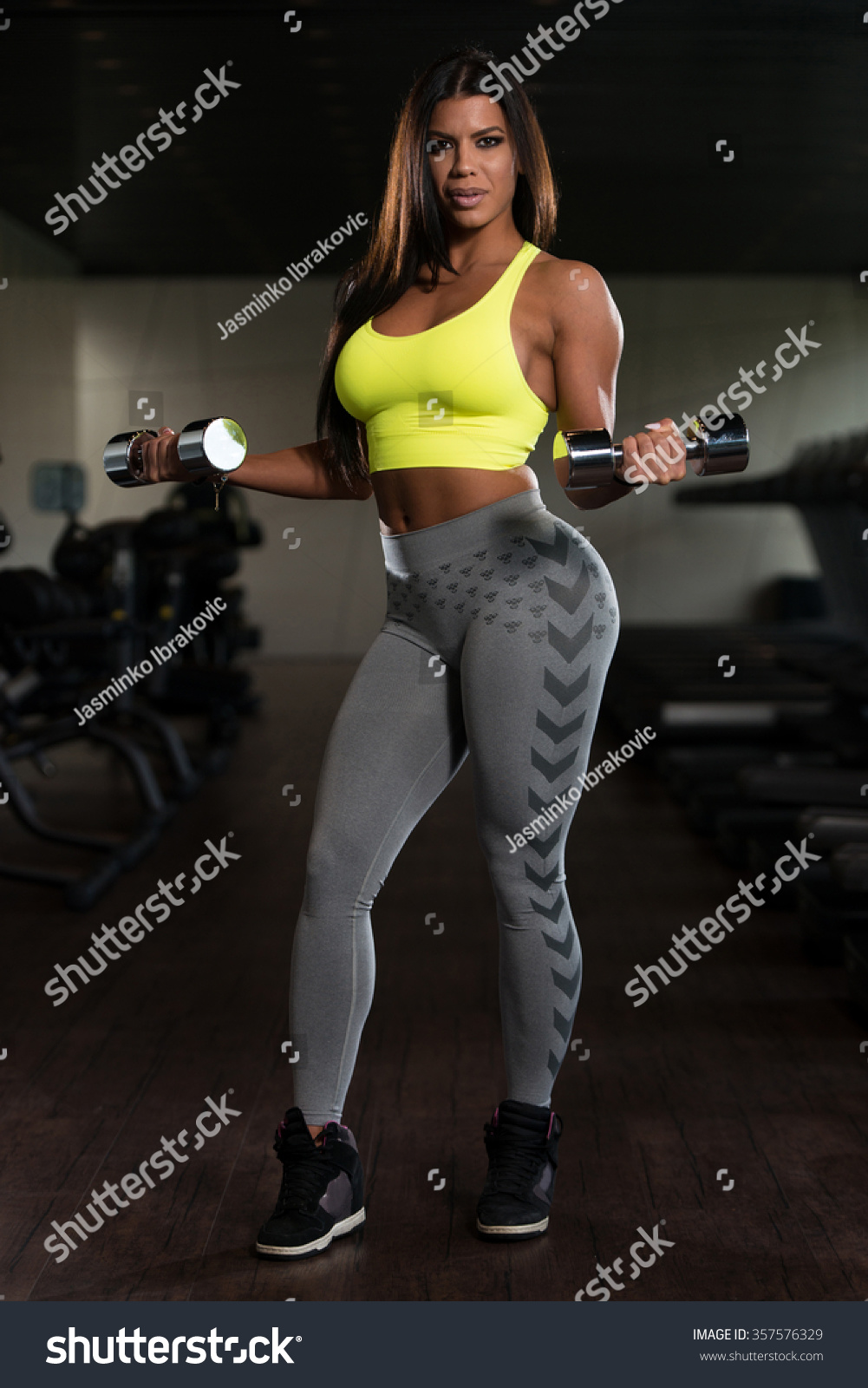 sexy latina woman working out biceps stock photo 357576329