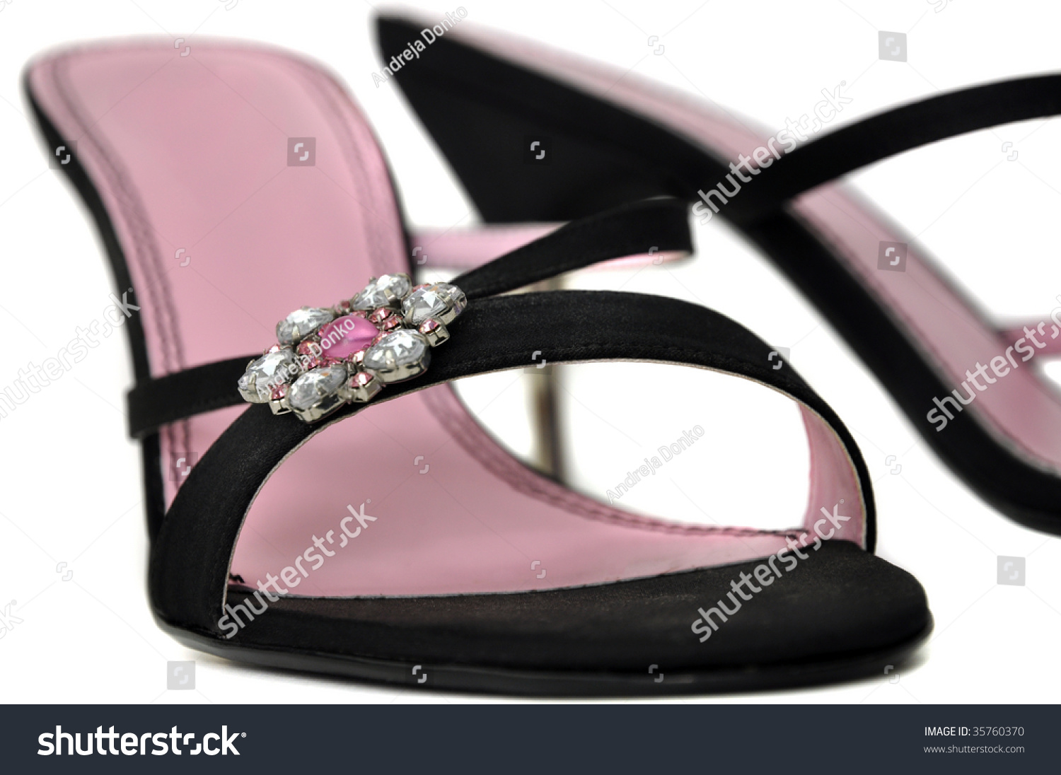 pink and black high heel shoes isolated on white stock