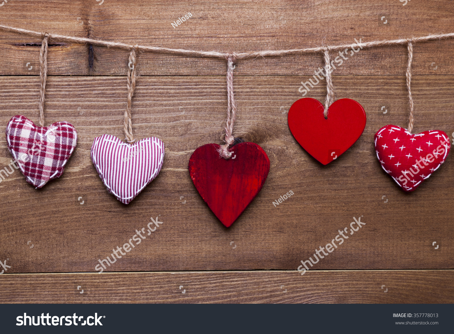 Many Red Hearts Hanging In A Line Brown Wooden Background Romantic