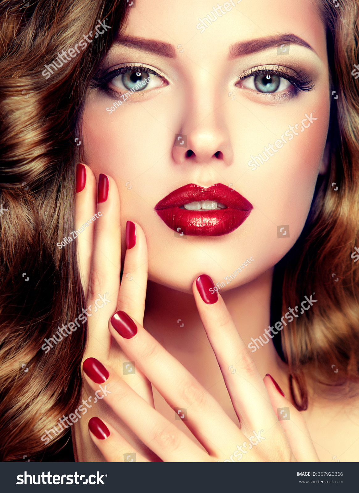 Beautiful Model Curly Hair Red Manicure Stock Photo