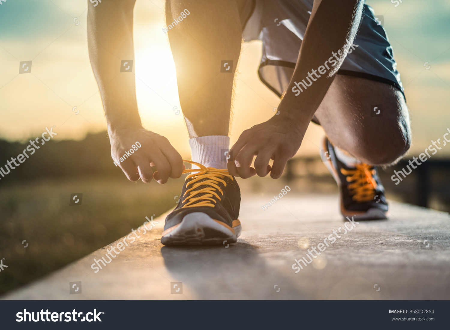 Man Tying Jogging Shoesa Person Running Stock Photo