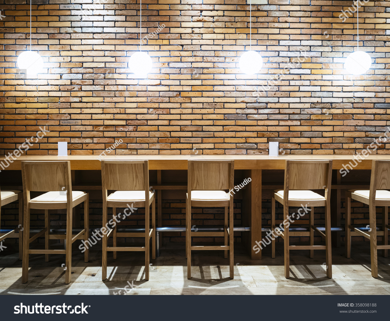 table counter bar chairs lights brick stock photo 358098188