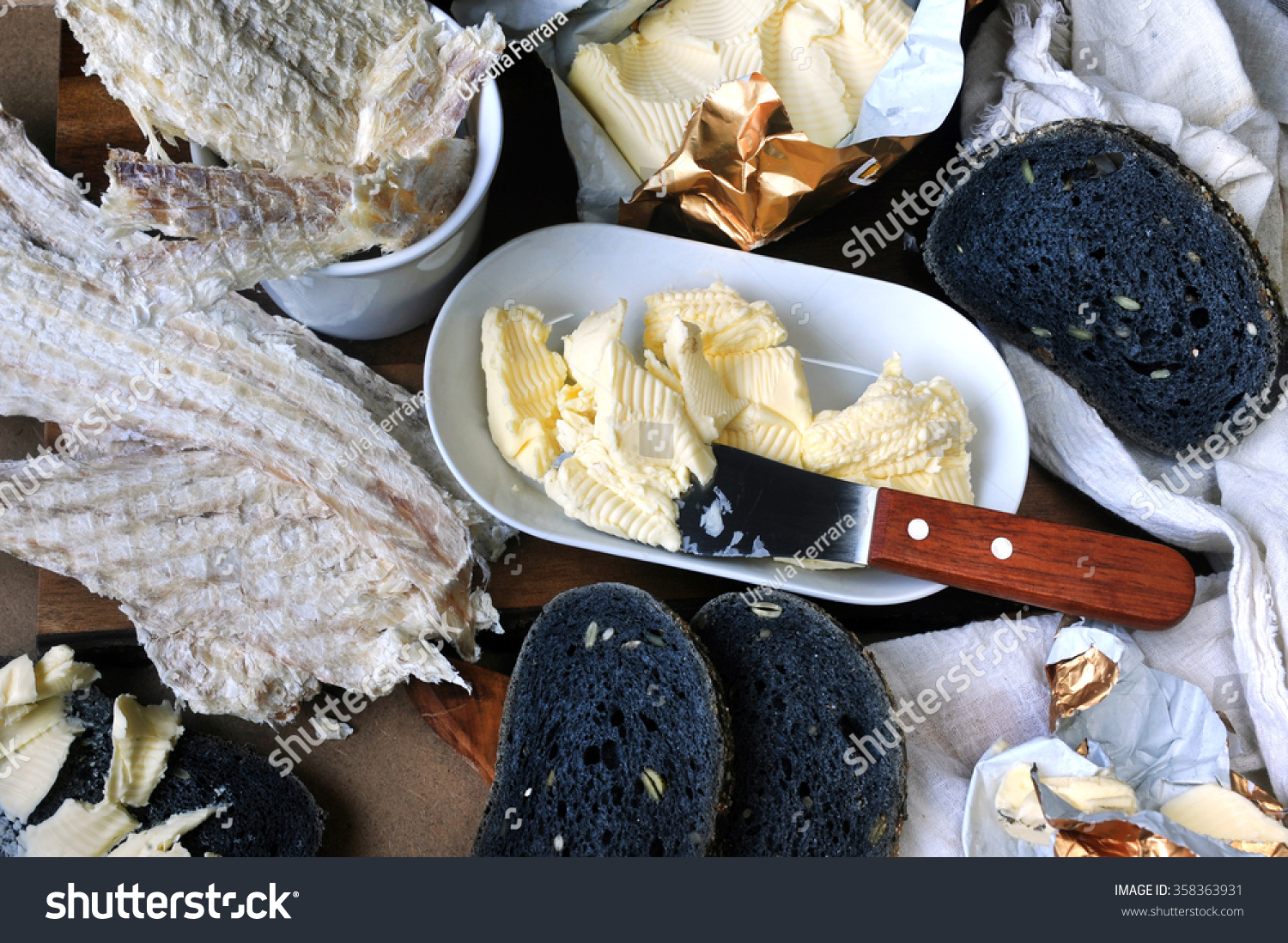 Icelandic typical dried fish hardfiskur charcoal stock for Fishing with bread