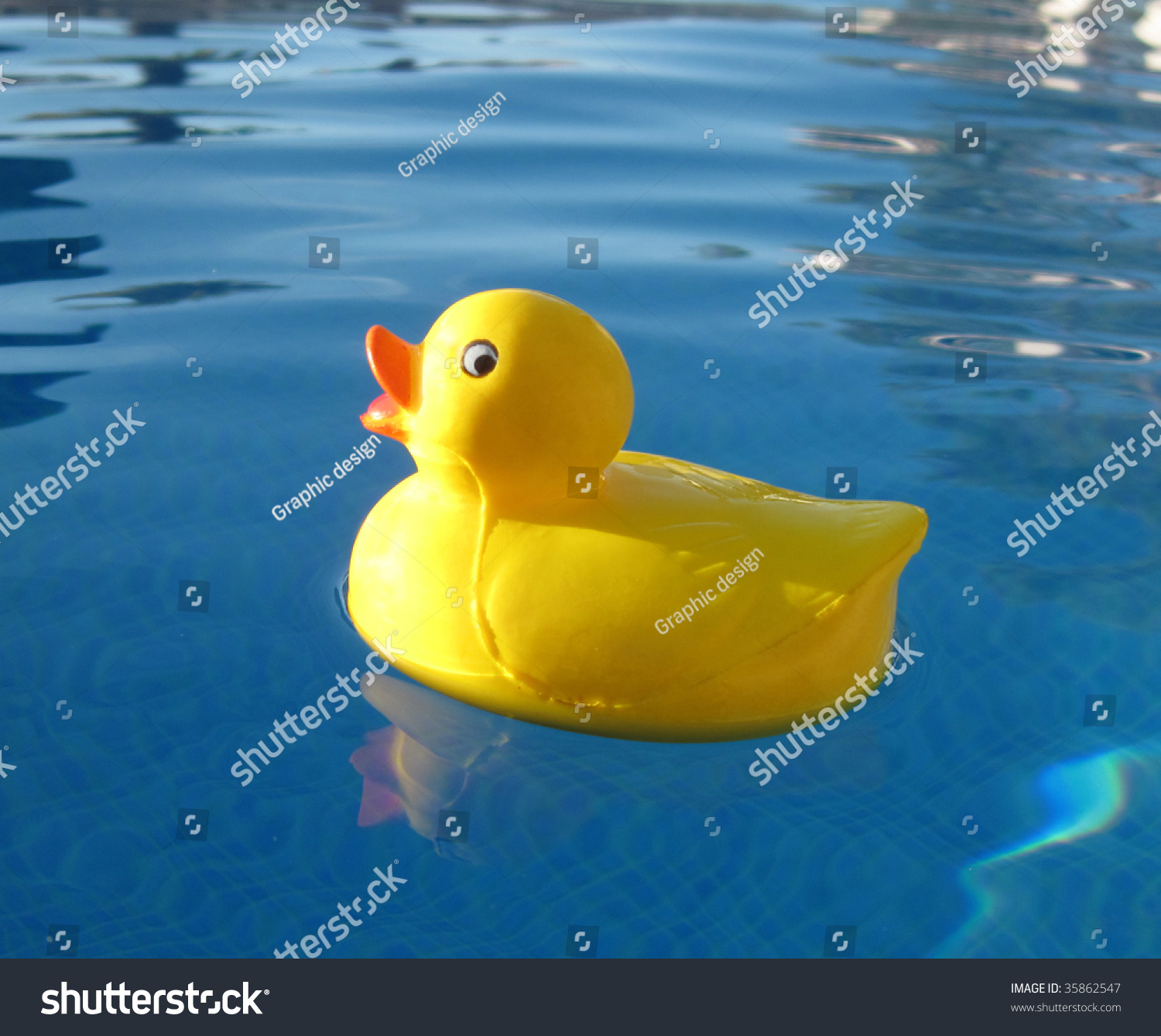 Happy Rubber Duck In The Swimming Pool Stock Photo