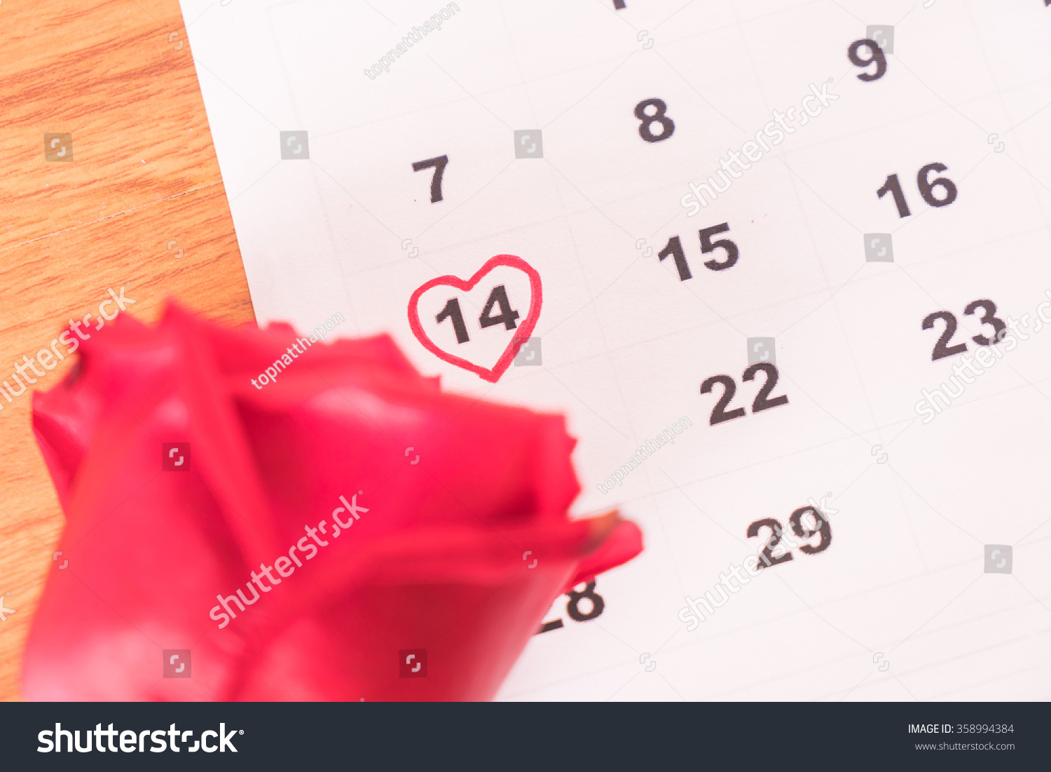 Calendar Rose Day : Red rose on calendar date february stock photo