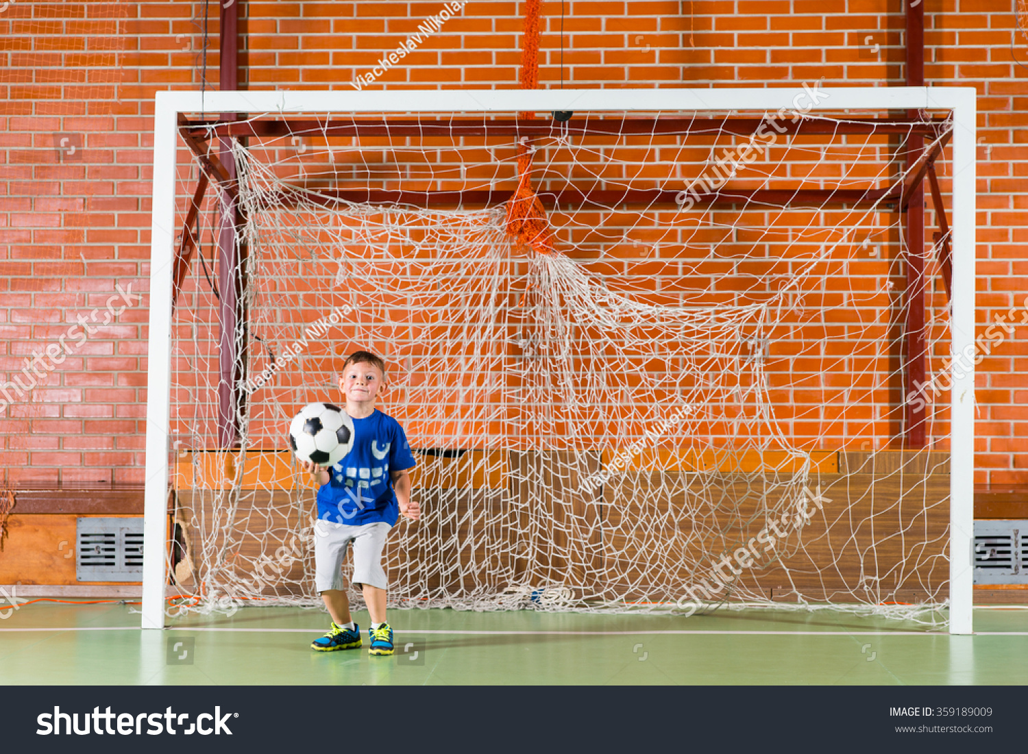 Young Boy Playing Goal Keeper Indoor Stock Photo 359189009 ...