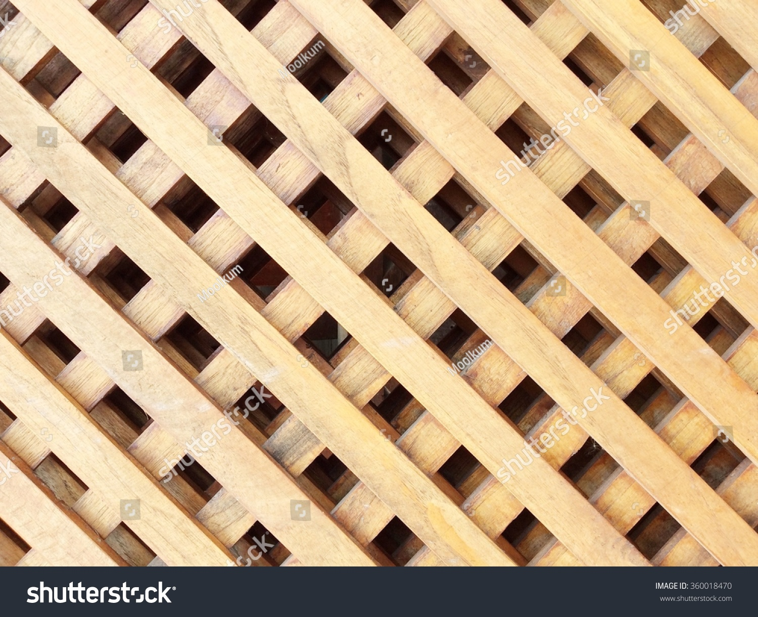 yellow wooden grille with diamond-shaped cells in the | EZ Canvas