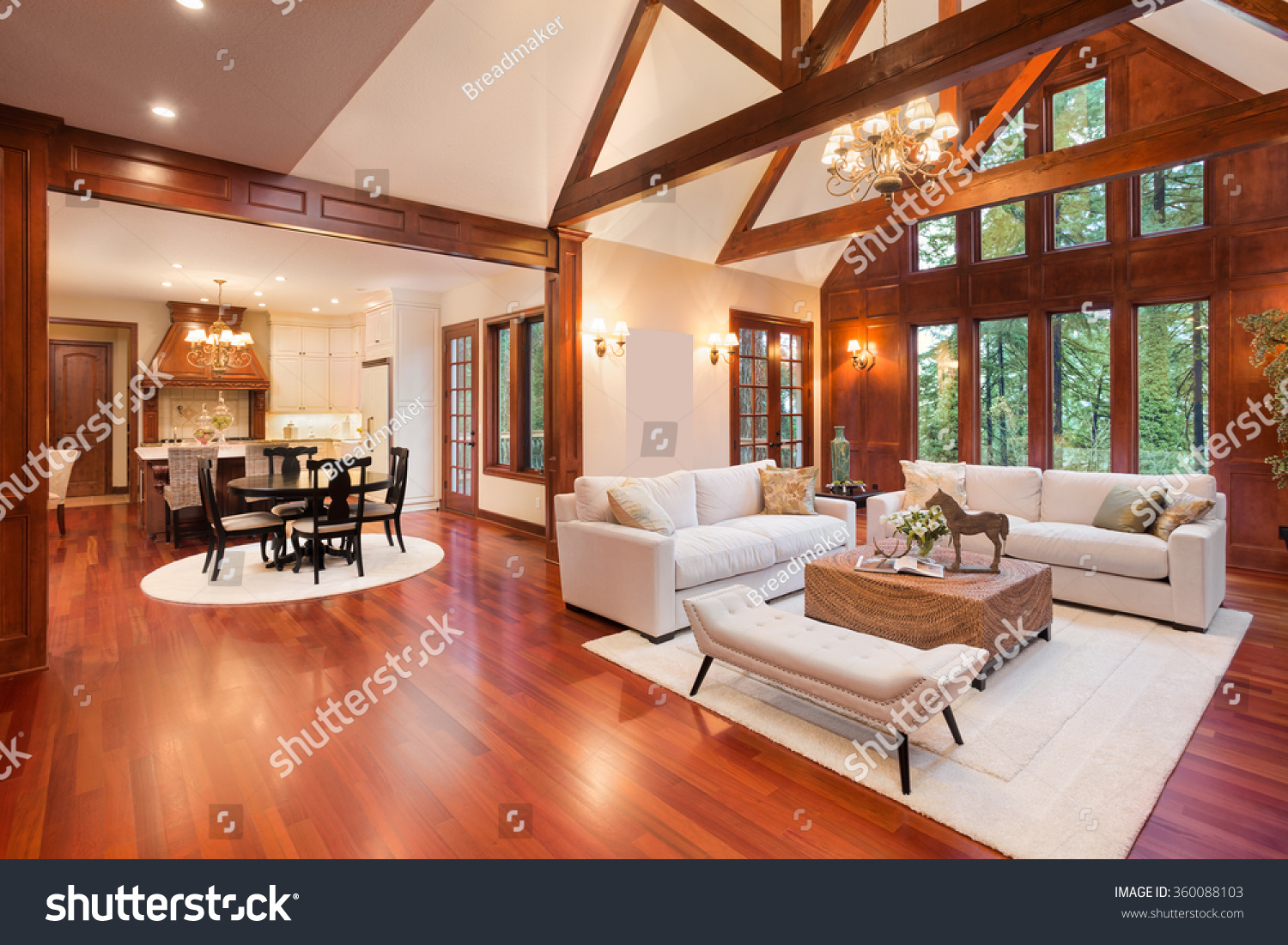 Beautiful And Huge Living Room With Hardwood Floors Tall Vaulted Ceiling Fireplace Couch