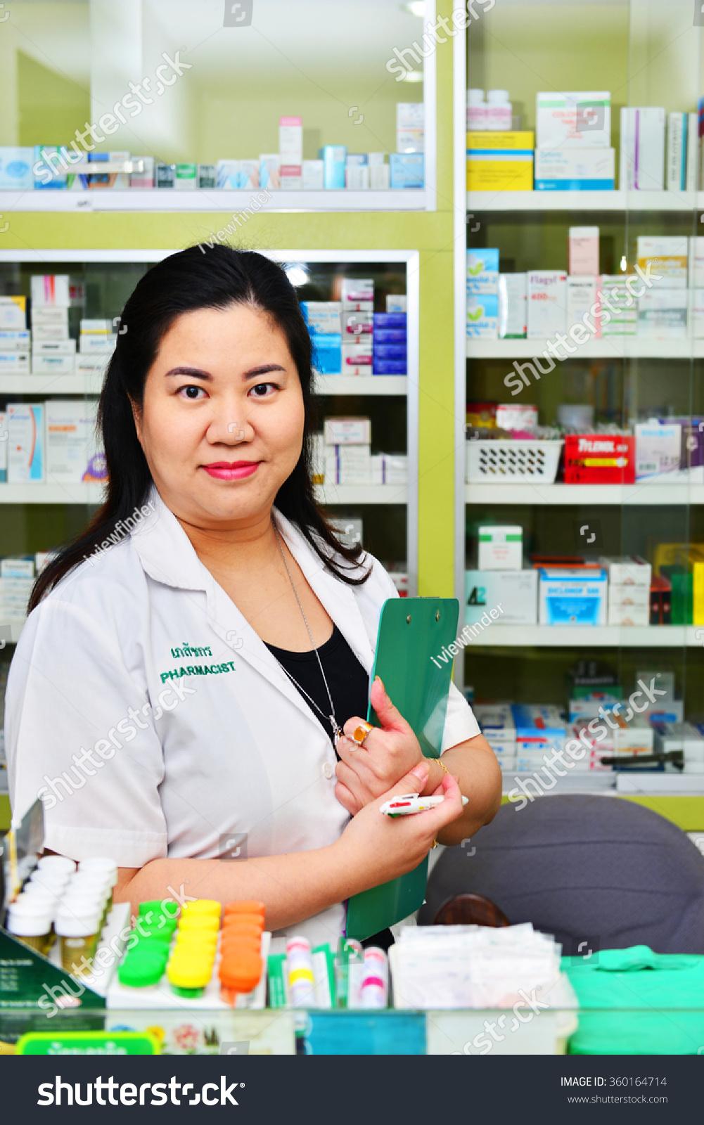bangkokthailand jan asian pharmacist chemist w stock photo bangkok thailand jan 9 asian pharmacist chemist w standing in pharmacy drugstore on