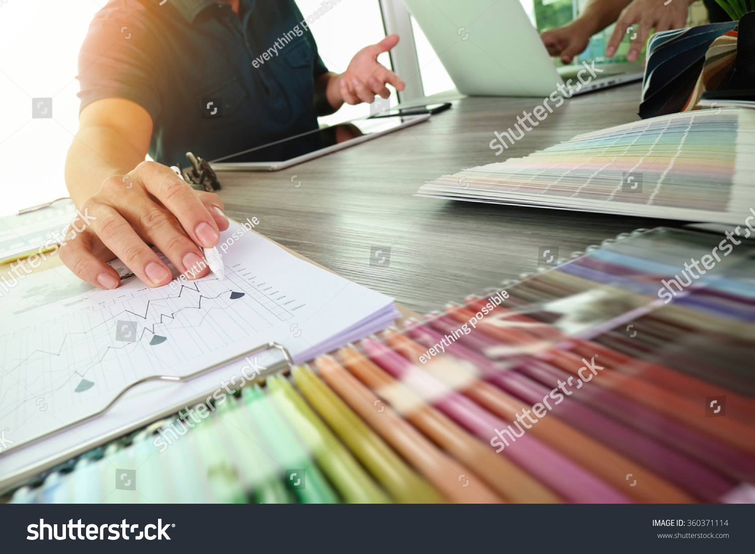 Two colleagues interior designer discussing data stock photo 360371114 shutterstock for Best tablet for interior designers