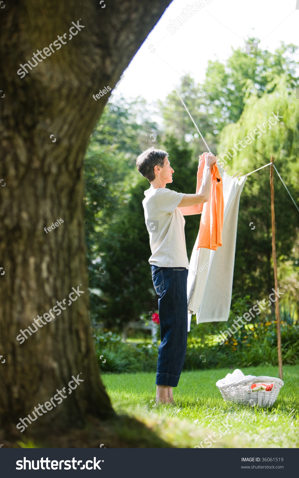 Woman Hanging Clothes Her Yard Stock Photo 36061519