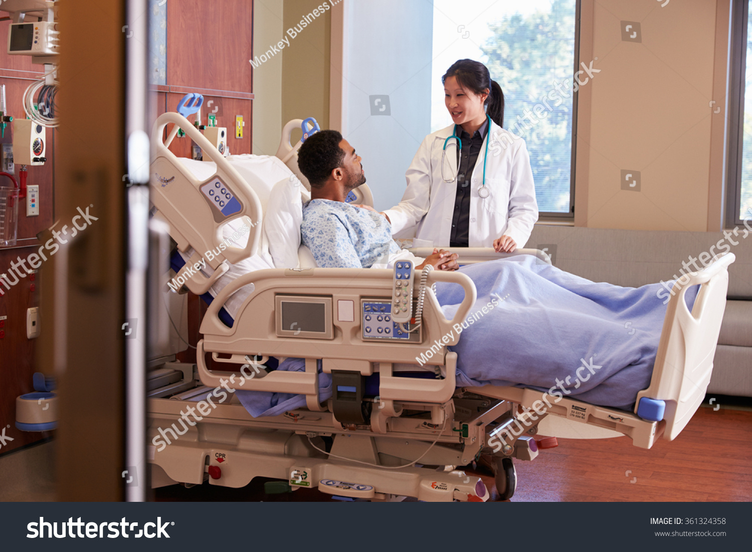 Female Doctor Talking Male Patient Hospital Stock Photo -5468