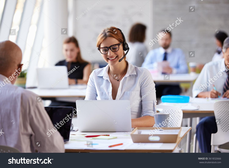 Businesswoman Using Laptop In Customer Service Department #361832666