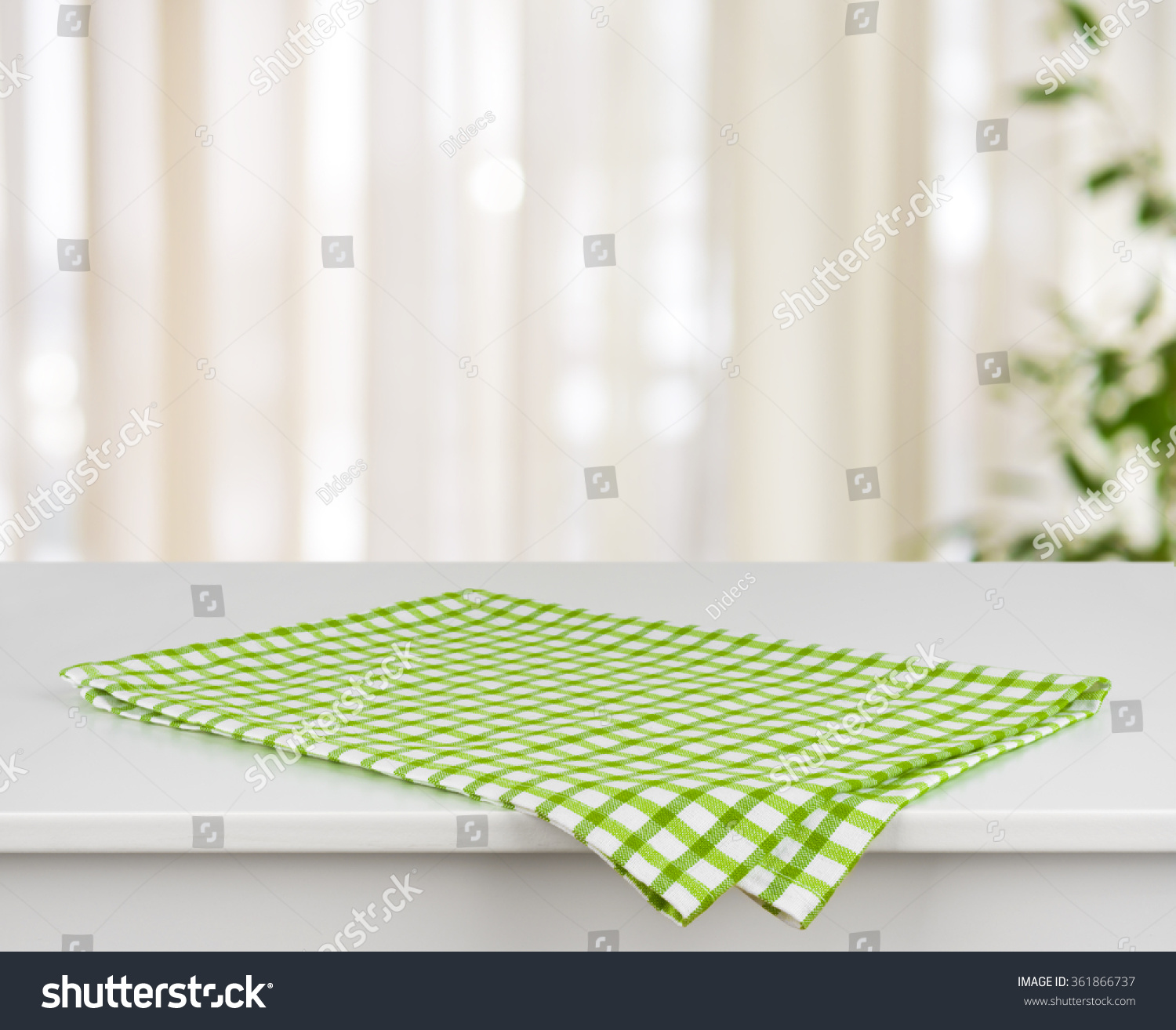 Green Checkered Kitchen Towel On Table Stock Photo (Royalty Free ...