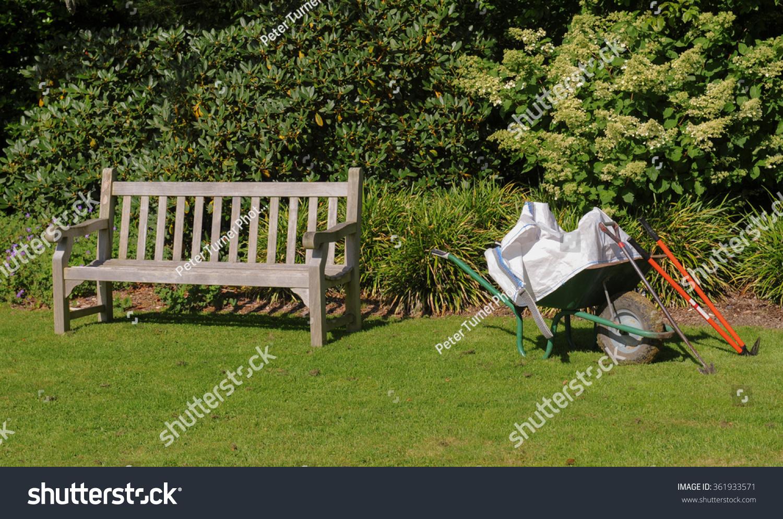 Wooden Garden Bench Next Wheelbarrow Garden Stock Photo