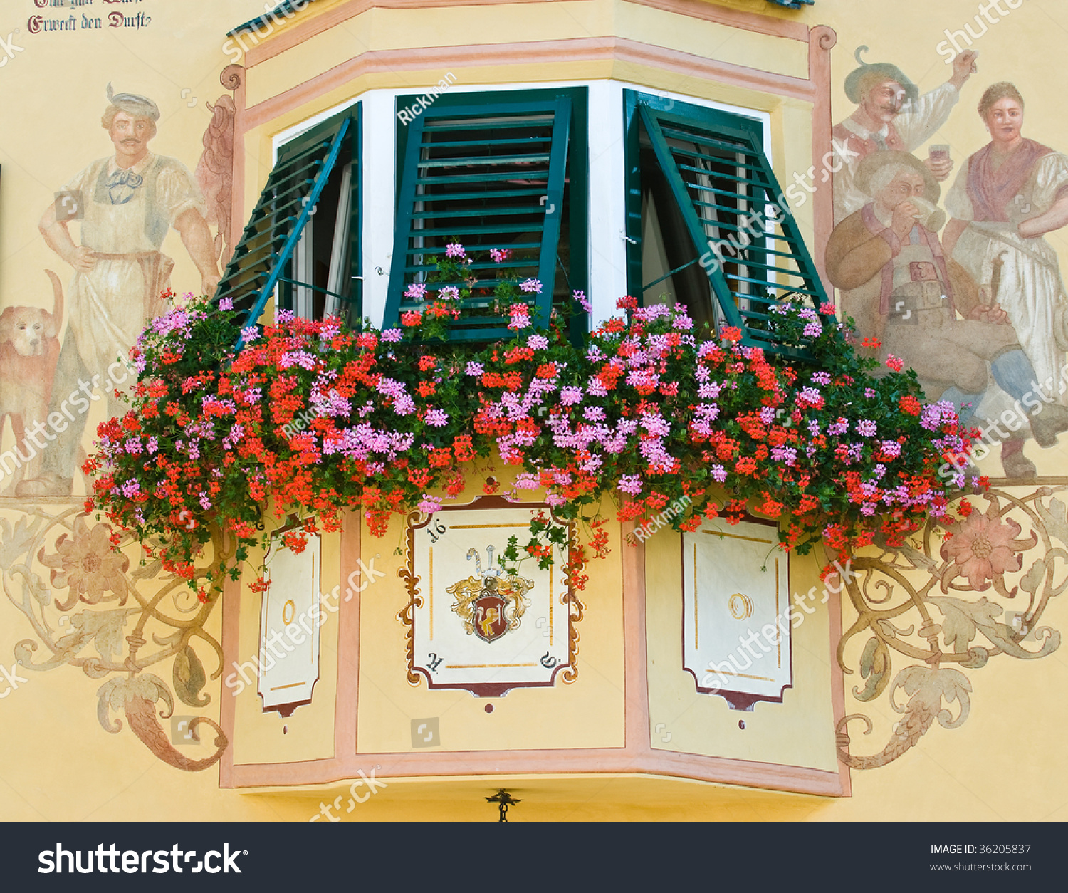 Flowers adorning a decorative bay window and adjoining for Adjoining wall