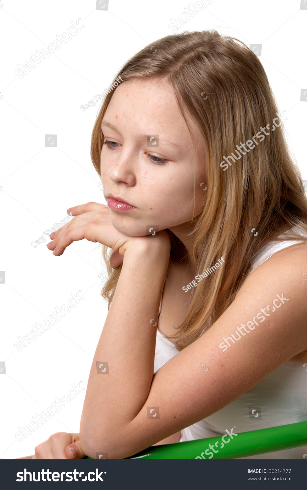 Sad Girl Sitting Alone Outside Stock Photos Sad Girl: Sad Little Girl Sitting On A Green Chair On A Light