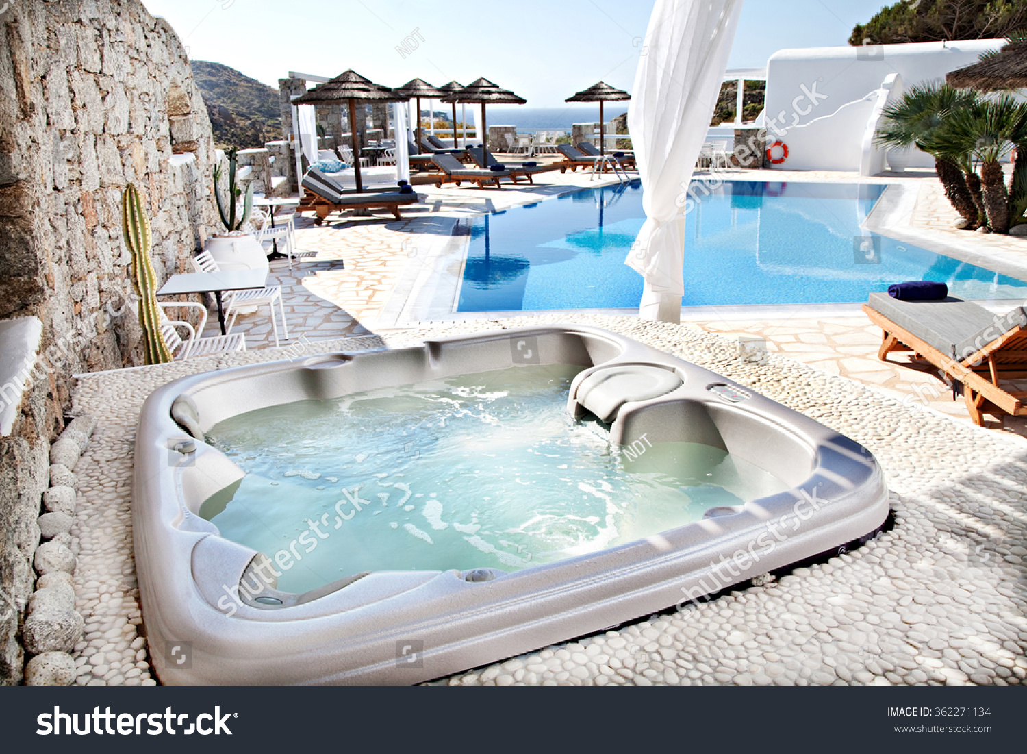 jacuzzi with a swimming pool in background stock photo. Black Bedroom Furniture Sets. Home Design Ideas