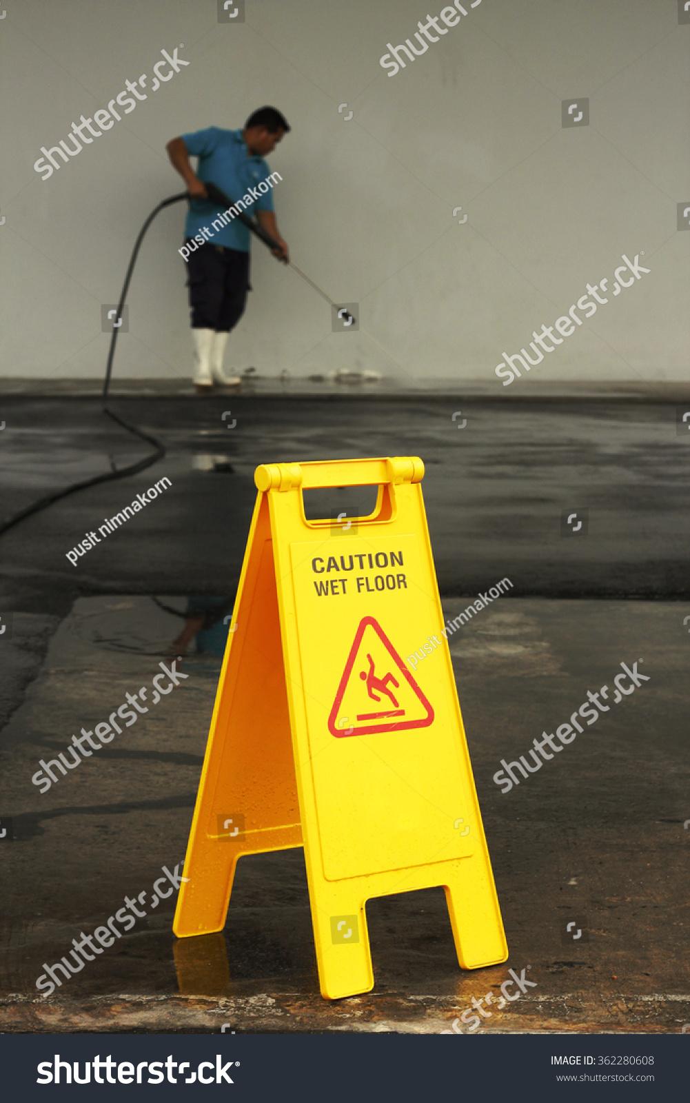 Caution wet floor banner worker cleaning stock photo for Floor banner