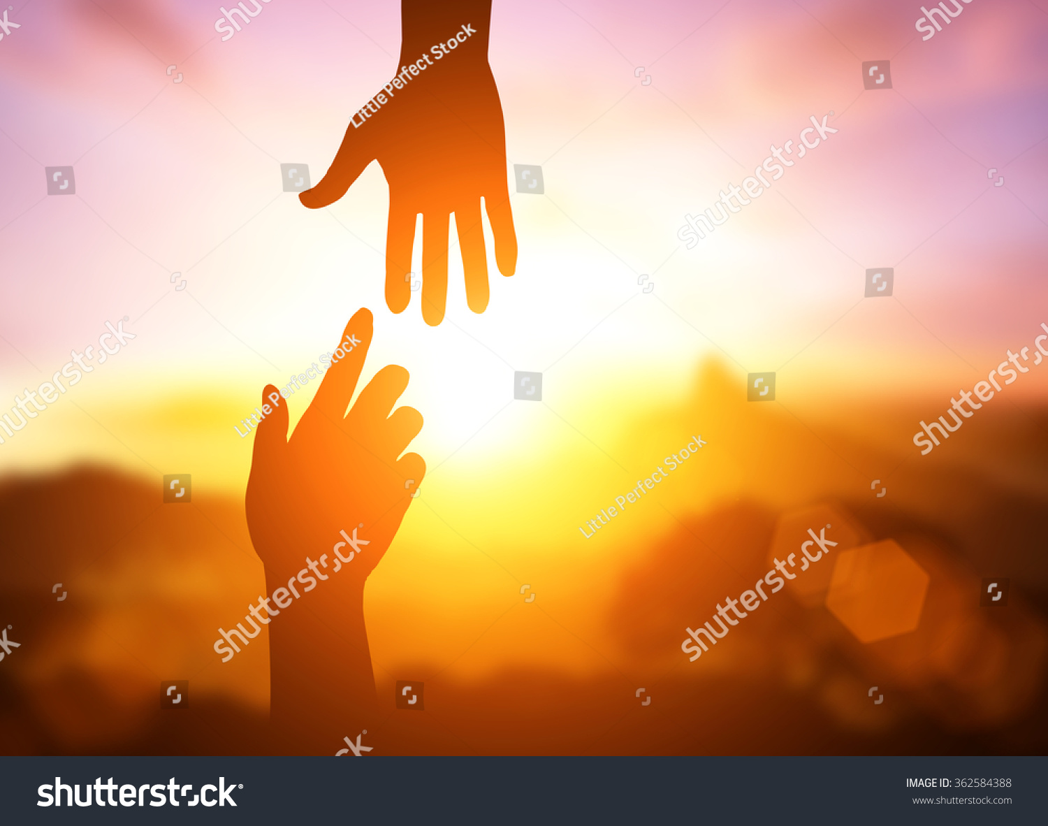 silhouette of helping hand concept and international day of peace.Thank You For Your Support. how can i help you. international day of peace.develop a friendship.please help me. #362584388
