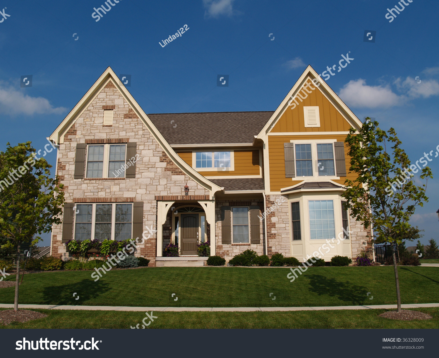 Two story stone brick and board sided residential home for Windows for residential homes