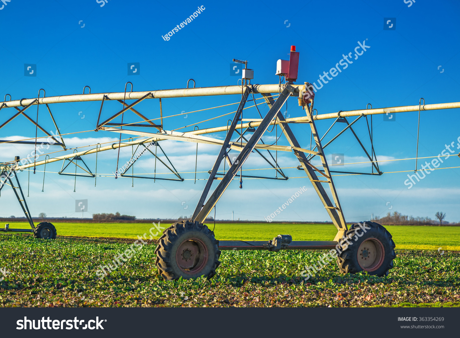 Automated Farming Irrigation Sprinklers On Cultivated Stock