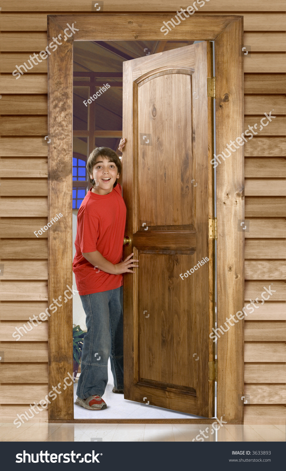 Boy Opening Wooden Door Front His Stock Photo 3633893