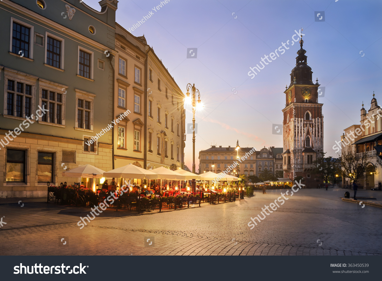 Tower of the town hall and caffe on the Krakow Market Square Poland Europe With light vintage toning