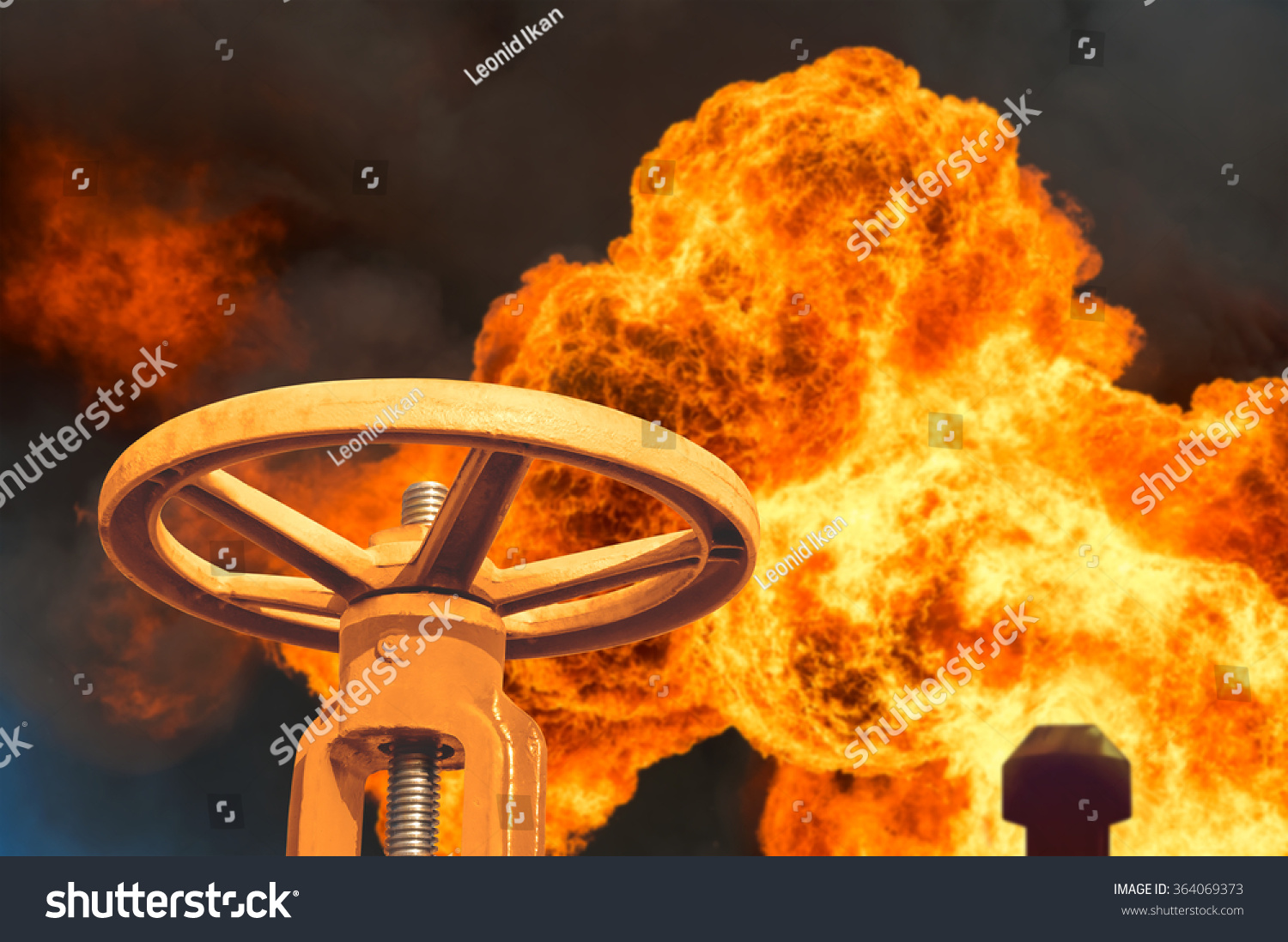 The gas valve on the background of flaming torch flame