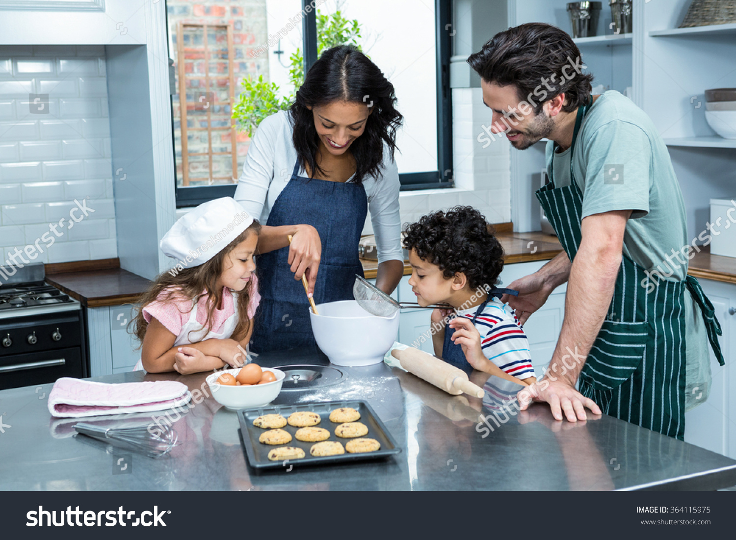 Family cooking kitchen - Happy Family Cooking Biscuits Together In Kitchen At Home