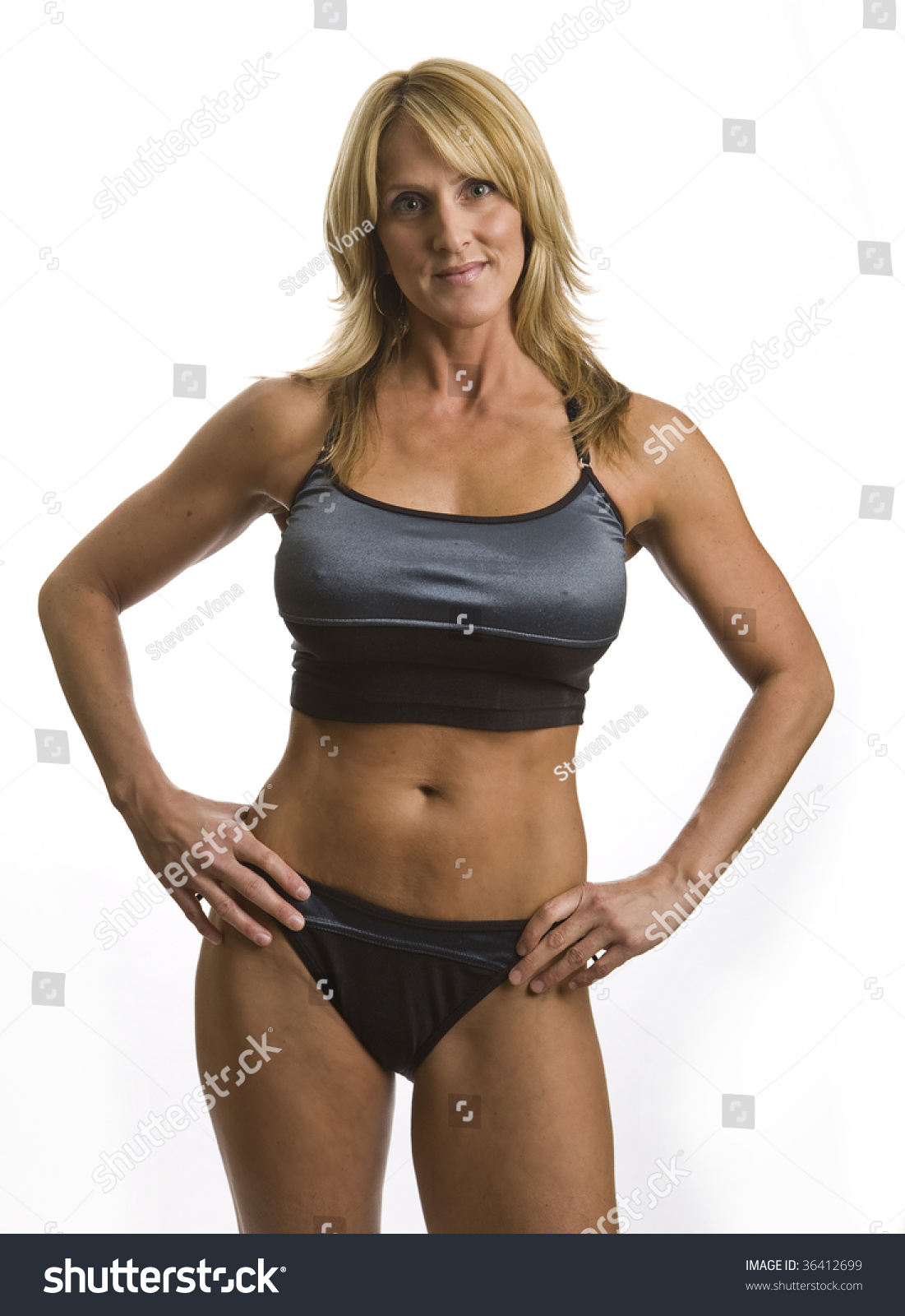 very fit mature woman work out stock photo (100% legal protection
