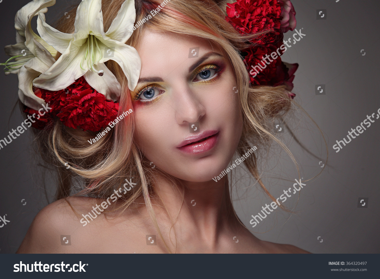 Portrait girl model beautiful hair flowers stock photo safe to use portrait of a girl model with beautiful hair and flowers in her hair fashion izmirmasajfo