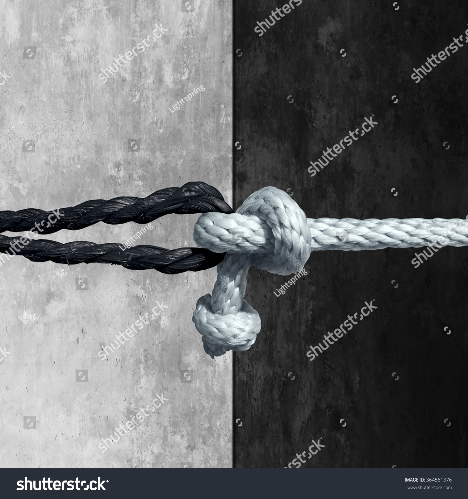 Racial unity concept symbol against racism stock photo 364561376 racial unity concept as a symbol against racism in society as a white and black rope biocorpaavc Images