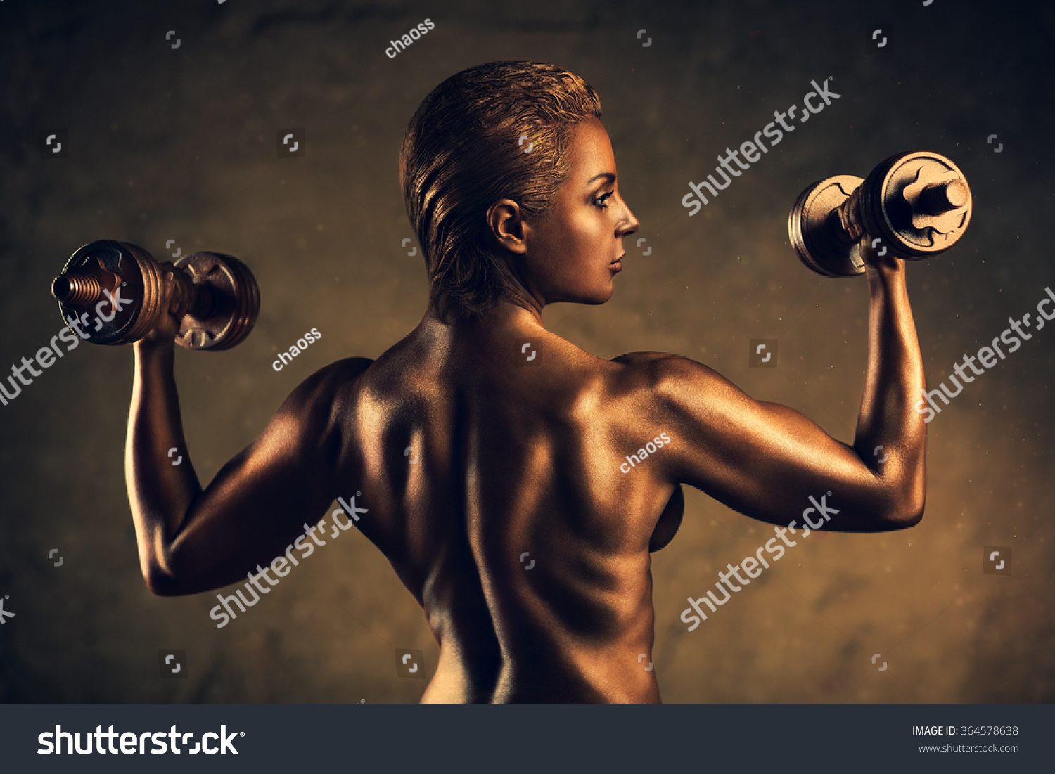 Strong woman bodybuilder standing nude on wall background. Ancient bronze  statue concept.
