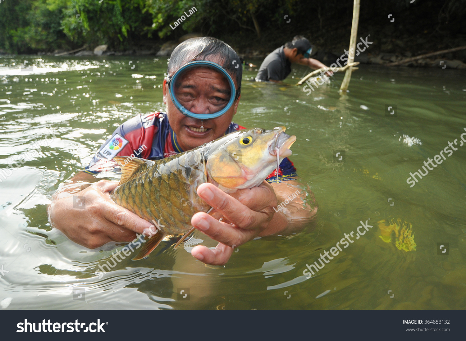 Freshwater fish in malaysia - Kiulu Sabah Malaysia Marc 13 2014 Unidentified Man Showing Freshwater Fish Called