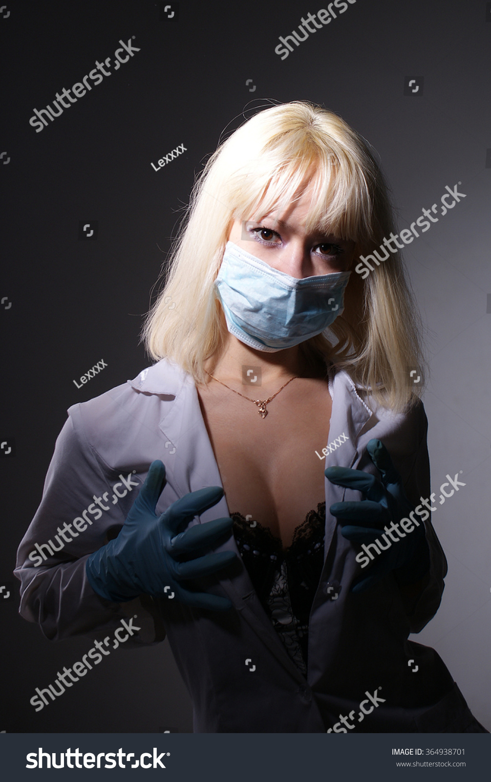 Young beautiful girl in nurse costume posing at studio.Isolated portrait