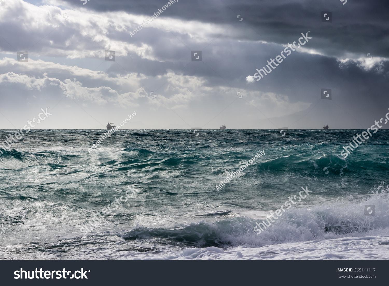 Ships in the stormy Mediterranean Sea near the coast of Antalya Turkey