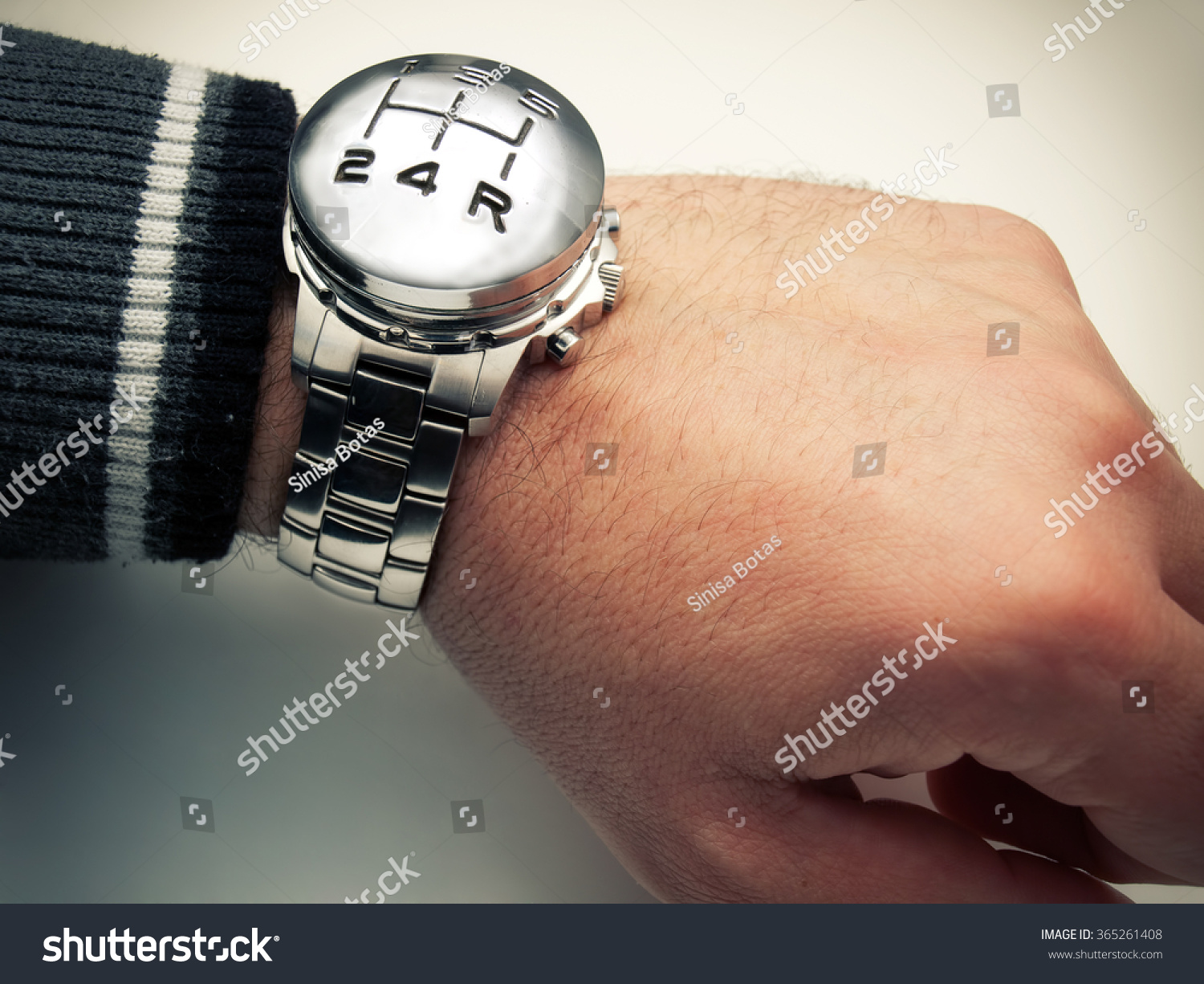 Watch marks on wrist - Conceptual Image With Speed Gear Stick Marks And Wrist Watch