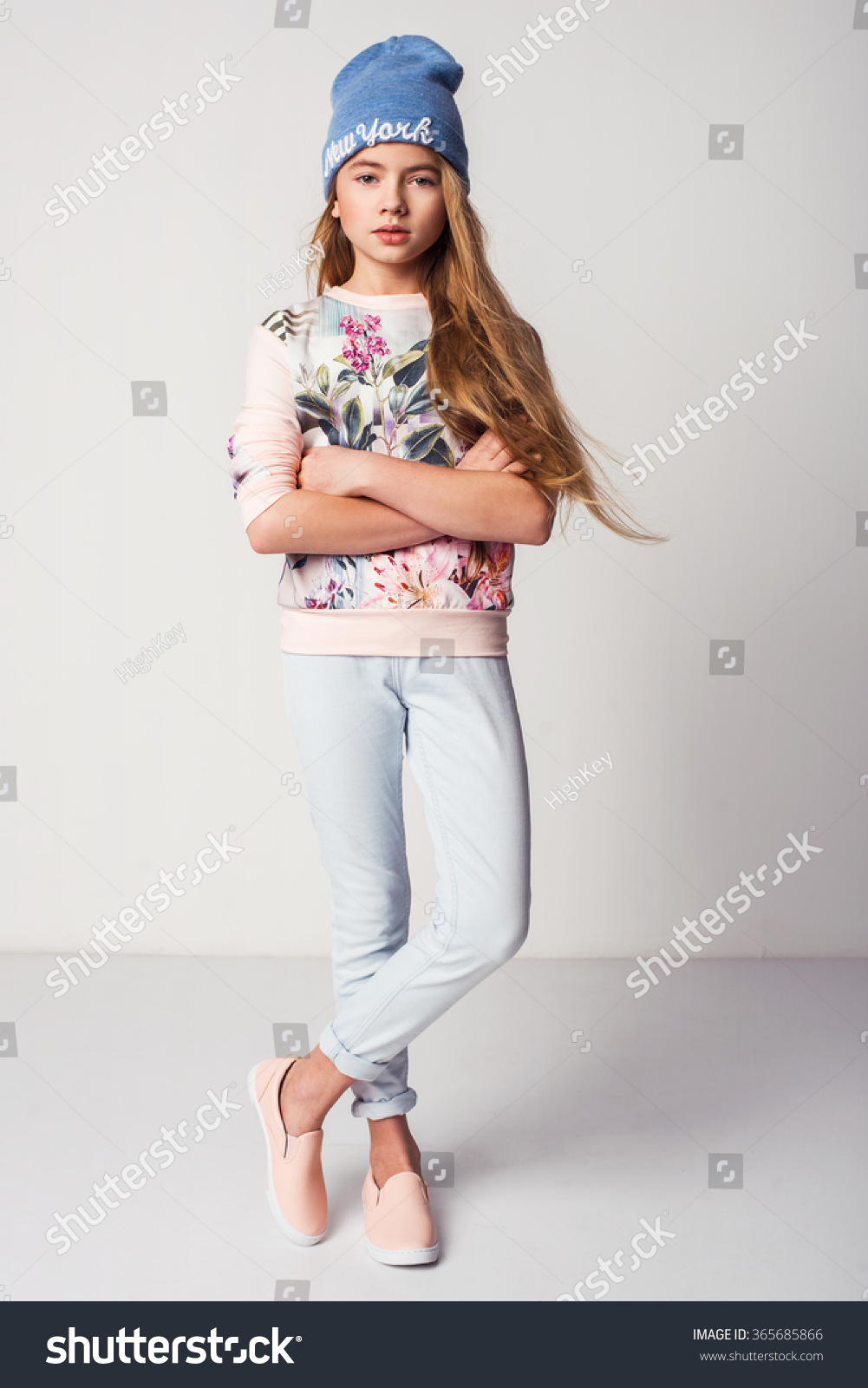 beautiful fashionable kid girl isolated on stock photo